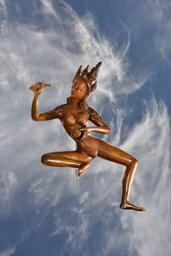 Tibetan Statue Yogini ascending into clouds