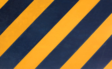 Yellow and black diagonal stripes texture background.