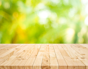 Real wood table top texture on blur fresh green garden background