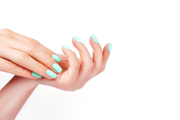 Aluminium Prints Manicure Hands of a young girl, manicure on a trendy background , green polish