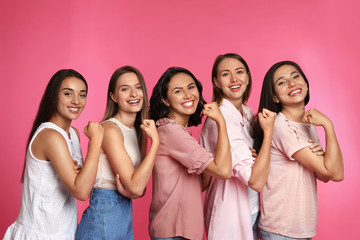Happy women posing on pink background. Girl power concept