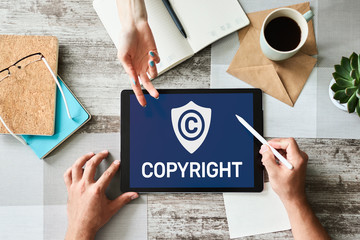 Copyright icon on screen. Patent Law and Intellectual Property. Business, Internet and Technology Concept.