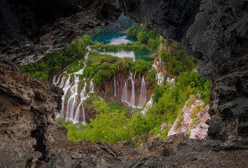 Wall Mural - Waterfall in the Plitvice Lakes National Park seen from a natural rock cave