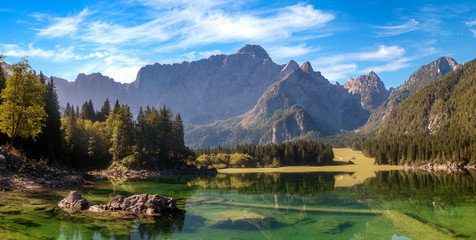 Fotomurales - Panorama of the beautiful mountain lake-Laghi di Fusine