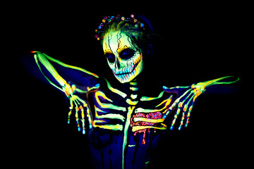 UV body art painting of helloween female skeleton
