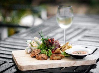 mixed asian seafood snacks platter on restaurant table