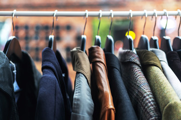 Clothes on the hangers at the flea market, low prices clothing concept, image with soft focus