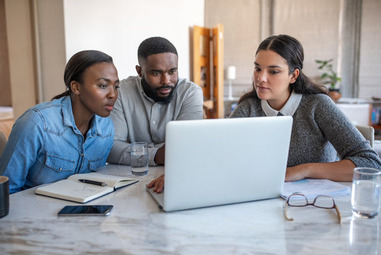 African American couple and their financial advisor using a laptop