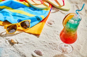 Colorful tropical cocktail on a sandy beach