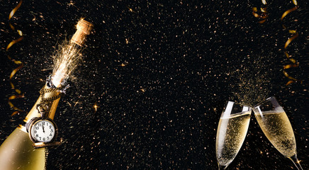 New year celebration party with champagne bottle and glasses toasting