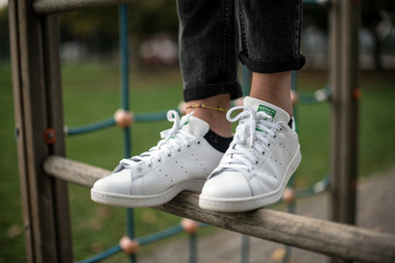 Milan, Italy - October 4, 2017: Adidas Stan Smith shoes in the street - illustrative editorial