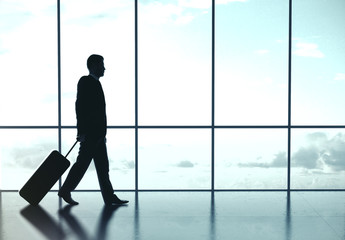 Fototapete - Businessman walking at airport