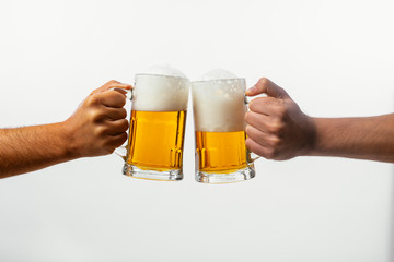 Foto auf Leinwand Alkohol Hands toasting with beer on white background