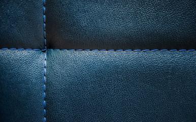 Shiny dark blue leather surface background