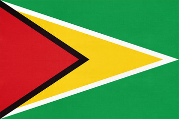 Photo sur Aluminium Amérique du Sud Guyana national fabric flag, textile background. American state official sign.
