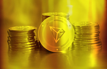 Tronix (TRX) digital crypto currency. Stack of golden coins. Cyber money.