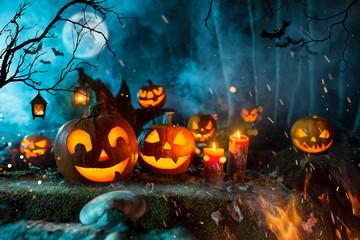 Halloween pumpkins on dark spooky forest with blue fog in background. Fototapete