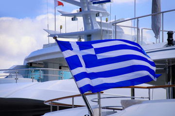 Greek national flag on a Yacht. Boating in Greece, Piraeus - Athens