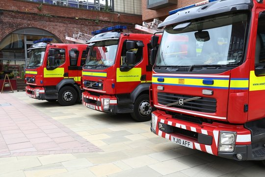 LEEDS, UK - JULY 12, 2016: Volvo truck fire engines Leeds, Yorkshire, UK. There are 36,000 firefighters in the UK.