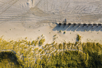 Dunes with green grass at beach in the Netherlands at the Northern Sea, drone shot