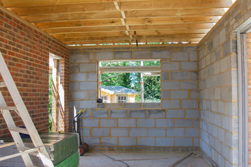 Residential renovation project unfinished garage in building blocks, roof structure