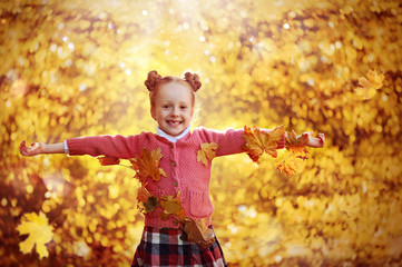 Happy red haired girl against autumn background