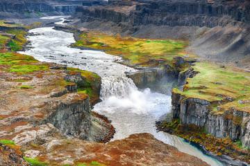 Fotobehang Blauwe hemel Fantastic view of canyon and waterfall Hafragilsfoss.