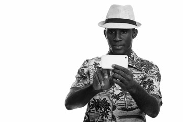 Young black African man taking picture with mobile phone