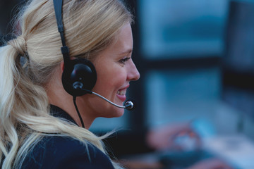 Customer service agent  woman with headset Working In a Call Center.