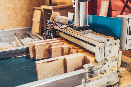 woodworking machine at a sawmill - forestry industry as a producer of raw materials for wood production