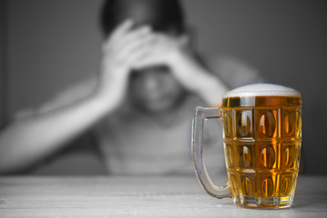 Wall Murals Bar glasses of Beer and background images are male headaches. The result of excessive alcohol consumption.
