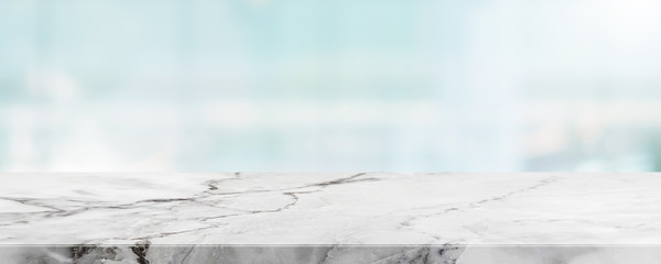Empty white marble stone table top and blur glass window wall building banner mock up abstract background - can used for display or montage your products.