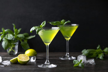 Gimlet cocktail with fresh basil leaves