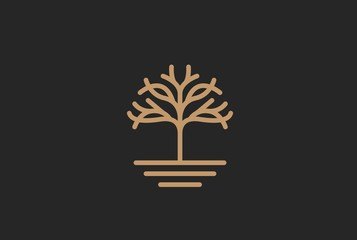 Modern symmetrical golden tree with leaf and soil logo design Wall mural