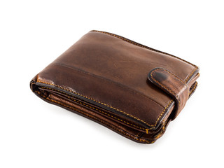 An old, worn and scratched wallet. Brown wallet on white background