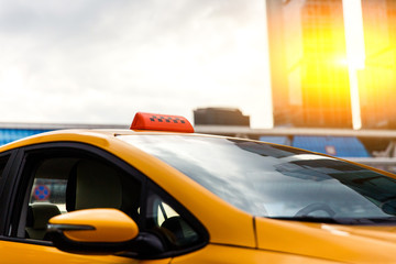Close-up photo of yellow taxi in city