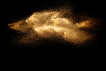 Brown dry river sand explosion isolated on black background. Abstract sand splash.