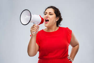 communication, feminism and human rights concept - woman in red dress speaking to megaphone over grey background
