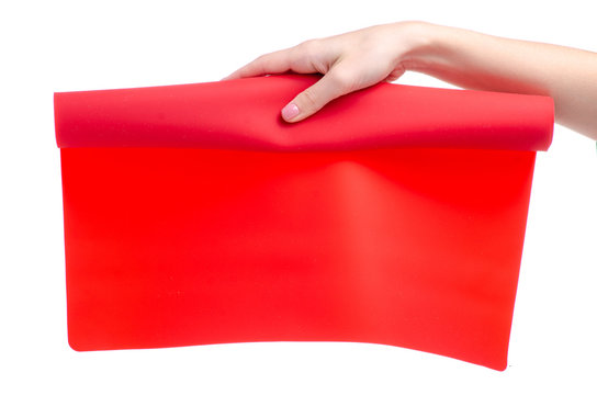 Silicone baking mat in hand on white background isolation
