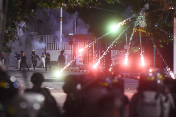 Firework exploded as protesters clash with police during a riot following protests near Indonesian Parliament building in Jakarta