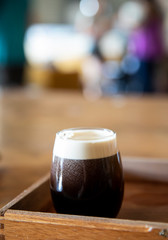 Glass of dark stout beer