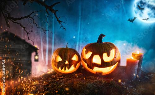 Spooky halloween pumpkins in dark mistery forest