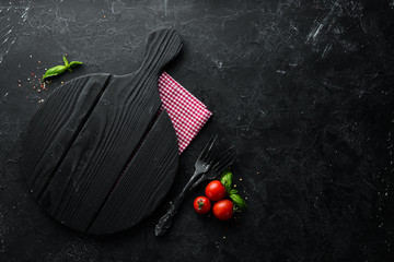 Black Stone Food Background. Cooking Ingredients. Top view. Free space for your text.