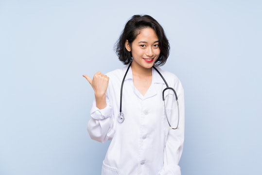 Doctor Asian woman pointing to the side to present a product