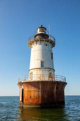 Hoopers Island Lighthouse seascape against blue skies