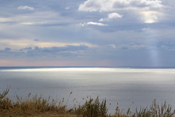 calm landscape sea merging on the horizon with cloudy sky