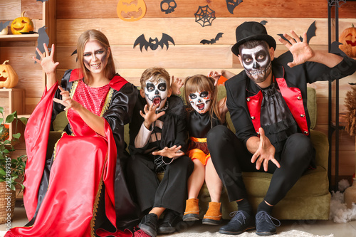 Family celebrating Halloween at home
