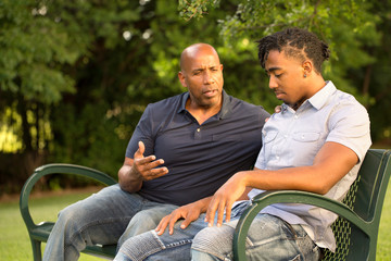 Mature man mentoring and giving advice to a younger man.