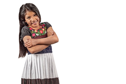 Portrait of beautiful Latin girl with embroidered blouse. Cute Mexican girl with great facial expression