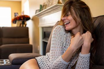 A Lovely Brunette Lingerie Model Poses In Lingerie In A Home Environment